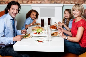 Family eating together in a restaurant