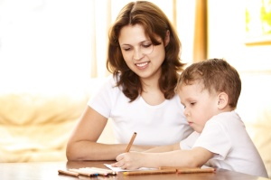 mother helping in homework to her son
