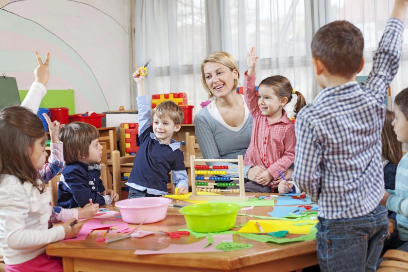 Teacher with children in kindergarten