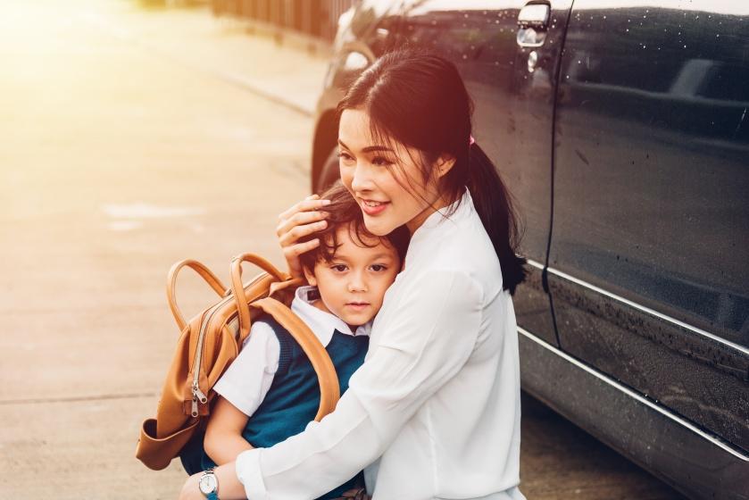 Family happy mother send children kid son boy kindergarten to school